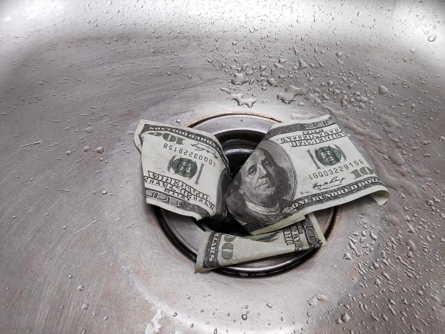 Stop Wasting Money, money down the drain